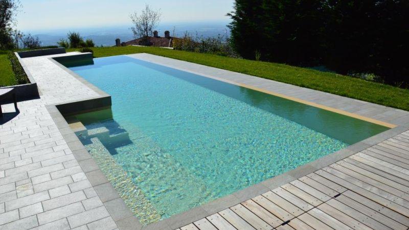 Poolbau mit freier Form: 6-Eck-Pool mit Steintreppe